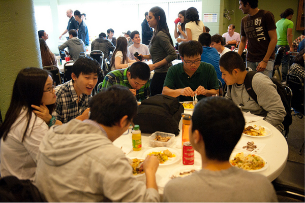 CultureWorks students at a potluck dinner at the Oshawa campus